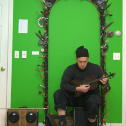 Stogie Performs Under the Portal of Skunkatude for the Opening Reception for the Art of the Ungrand at Mobius